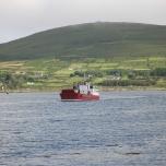 A boat returns to port in Castletownbere.