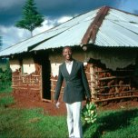 Kip Keino, outside the one-room hut he lived in when he left for Mexico City and the 1968 Olympics (1992).