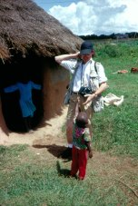 Then Dallas Morning News photographer David Leeson with one of the orphans raised by Kip Keino and his wife on their farm outside Eldoret, Kenya (1992). In 2004, David won a Pulitizer Prize for his photographs during the second Gulf War.