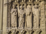 Statues in the façade of Notre Dame in Paris. St. Denis is the one holding his head in his hands.