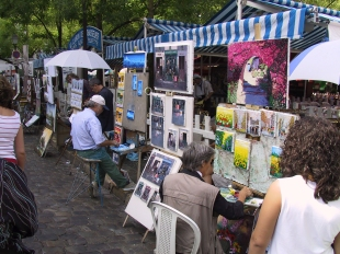 Artists at work in a park atop Montmarte in Paris.