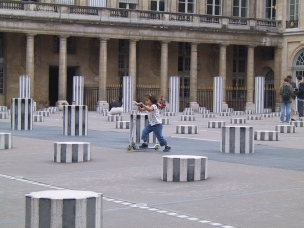 Playing on a kick scooter at the Palais Royal in Paris.