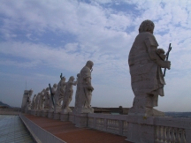 Statues overlooking St. Peter's Square, from atop the façade of St. Peter's Basilica.