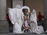 Human statues with a young tourist outside the Uffizi in Florence.