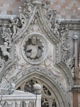 Pigeons roost in an elaborate carving in Venice.