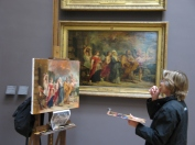 An artists refines her talent by copying a portion of a painting at the Louvre in Paris.