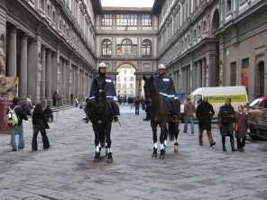 Two mounted police officers in the plaza between wings of the Uffizi in Florence.