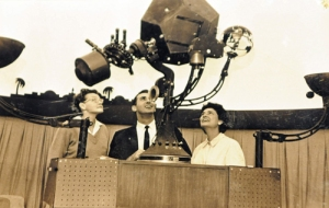 Ernestine Gilliland, Denny Stevens and Patty Carey all look at the Spitz A-2 star projector in an old photo from Patty Carey's scrapbook of the Hutchinson Planetarium, which started in the Poultry Exhibit building at the Kansas State Fair in 1962.